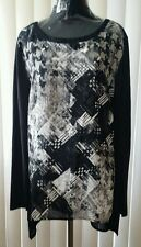 Women's black/white 100%Polyester blouse/cami  size L, long sleeves.