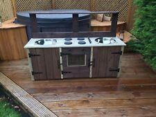 child's wooden mud kitchen garden playroom playground nursery school pre school