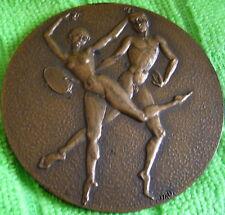 Médaille en bronze ( danse érotique) Signé J.A.D