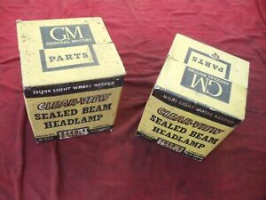 GM clear beam headlamp bulbs number 5040-S pair new old stock 3748269 6 volt