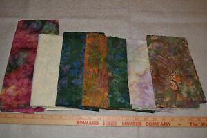 Lot of 7 cotton batik fabric pieces, mixed colors/designs, each 1-2 yards each