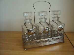 A Vintage 3 Glass  Decanter Tantalus With Metal Name Shields