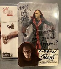 SAW JIGSAW KILLER SIGNED TOBIN BELL/LEIGH WHANNELL FIGURE REEL TOYS NECA
