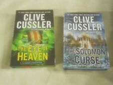 2 books by CLIVE CUSSLER BOOK-- The Solomon Curse and THE EYE OF HEAVEN ~3889