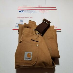 Excellent condition youth Carhartt bibs. Size 8 Small brown