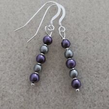 Handmade sterling silver earrings with purple and silver beads