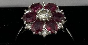 18CT WHITE GOLD VINTAGE RUBY AND DIAMOND CLUSTER RING. ( VALUATION OF £4200 ).