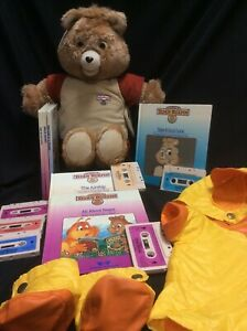 Teddy Ruxpin 1985 LOT of 6 books, 6 tapes, 2 outfits, 1 bear(needs repair)