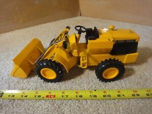 Vintage Ertl John Deere, 1/16 wheel loader, diecast bucket excavator model.