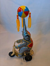 TIN TOY ELEPHANT WIND UP ON SCOOTER SPINNING BALL/TASSELS VTG WORKS GREAT BEACH