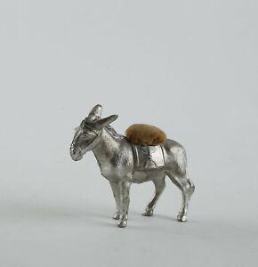 Antikes figürliches Nadelkissen. Esel mit Nadelkissen. Metall