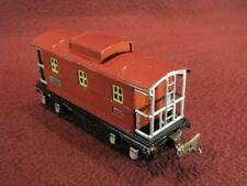 LIONEL PRE-WAR 657 CABOOSE - RED W/ YELLOW WINDOWS