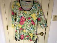 Woman's Peter Nygard size medium asymmetrical 3/4 sleeve polyester top