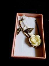 White rose pendant on a chain