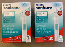 Two PHILIPS SONICARE SERIES 2 PLAQUE CONTROL RECHARGEABLE TOOTHBRUSH, NEW