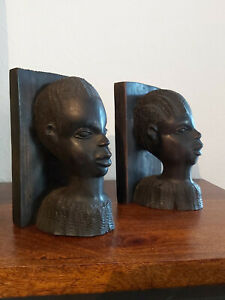 A SET OF VINTAGE SOLID DARK WOOD AFRICAN BOOKENDS FROM KENYA