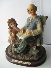 The Juliana Collection Old Man with Child Reading Book figurine