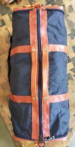 Sac de voyage Longchamp cuir et toile pliable 58x30x23 environ