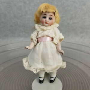 """4-1/2"""" antique all bisque German Miniature Dollhouse Doll with glass eyes marked"""