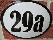 Hausnummer Oval Emaille schwarze Zahl Nr. 29a  weißer Hintergrund 19 cm x 15 cm