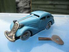 VINTAGE TIN PLATE CLOCKWORK SCHUCO SALOON CAR