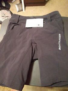 """Woman's padded bike shorts brand new """"Bontrager"""" XS color black with purple zip"""