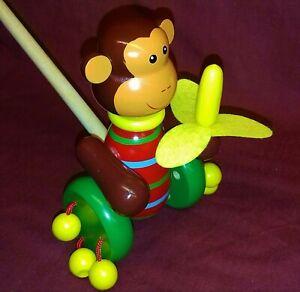 Push-along - monkey with a banana. Little monkey toddler