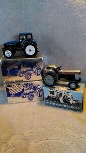 2)1/43 scale Ertl Toy Farmer New Holland 8260, 1White 2-35 Field Boss 1/25 scale