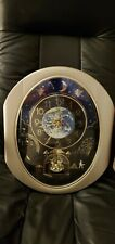 Cuorum Peaceful Cosmos Rhythm Small World Motion Wall Clock