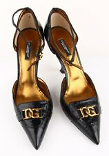 DOLCE GABBANA HEELS IN EEL SKIN AND BRASS HARDWARE IN EXCELLENT CONDITION