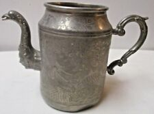 Chinese Huikee Swatow pewter jug engraved with Dragon Flowers Bird Man's Face