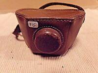 ancien petit étui en cuir marron pour mini appareil photo espion ELJY LUMIERE