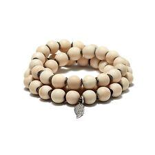 White bead and pave diamond pendant bracelet