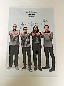 PERSONALLY SIGNED/AUTOGRAPHED WEEZER POSTER. RIVERS CUOMO
