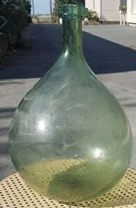 Bonbonne Dame Jeanne ancienne verre  bullés  10 litres.