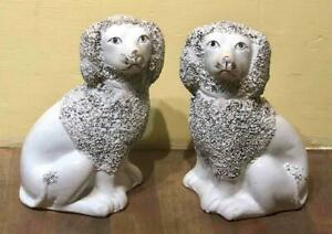 Pair of Staffordshire Poodle Dog Figurines, England, c. 19th Century