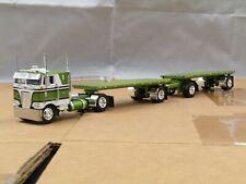 Dcp Custom green/white Peterbilt 352 w/custom hay double pup trailers 1/64