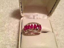 BAND STYLE RING SIZE 6.5 WITH MARQUISE 1.75CTS. RUBIES IN SS925