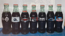Collection Of 7 Commemorative Coca Cola Bottles
