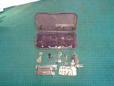 Vintage SINGER sewing machine attachments in original tin box