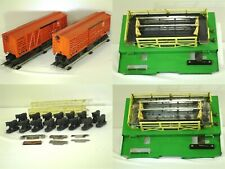 LOT OF 2 - POST-WAR LIONEL No. 3656 OPERATING CATTLE CARS & CORRALS (1952-53)