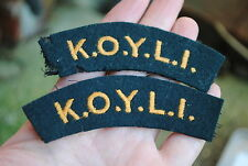 Koyli green and yellow shoulder titles