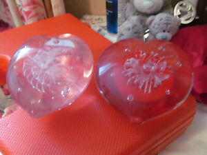 """PAIR OF HEART SHAPED GLASS PAPER WEIGHTS ONE RED AND PINK APPROX 3"""" AT WIDEST"""
