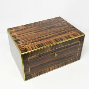 Superb quality coromandel dressing box with gilt brass fittings by Asprey.