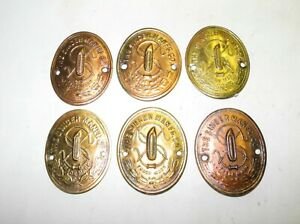 LOT OF 6 VINTAGE SINGER SEWING MACHINE BRASS FINISH LOGO MEDALLIONS, UNTOUCHED