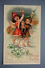 R&L Postcard: Greetings, Christmas, German Print Embossed Angel Drinking 1908