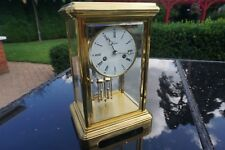 A Giant Four glass mantel carriage clock by Angelus