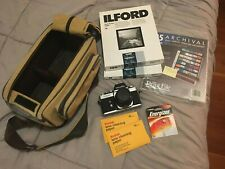 minolta-xe-5 film camera with 45 mm lens, bag, contact sheets, sleeves, etc