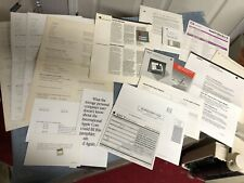 tableful of Miscellaneous Apple / Macintosh collectible materials