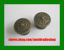 Early 1930s Majestic Radio wood knobs with gold color ornate brass embossed top